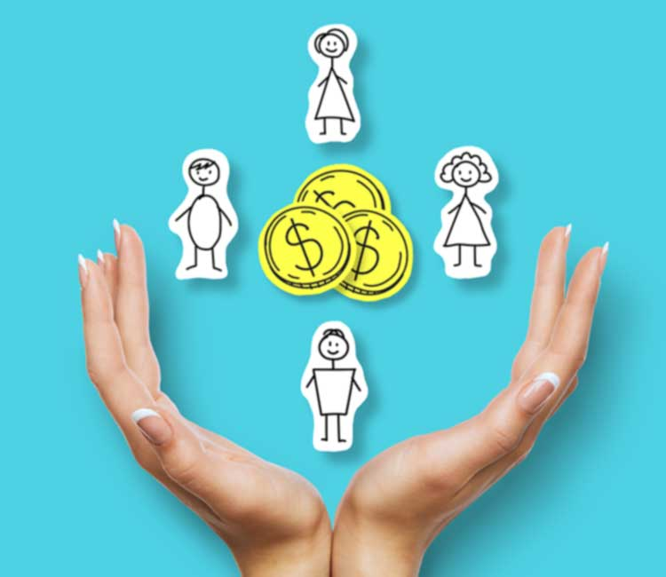 hands holding paper cut outs of family and coins