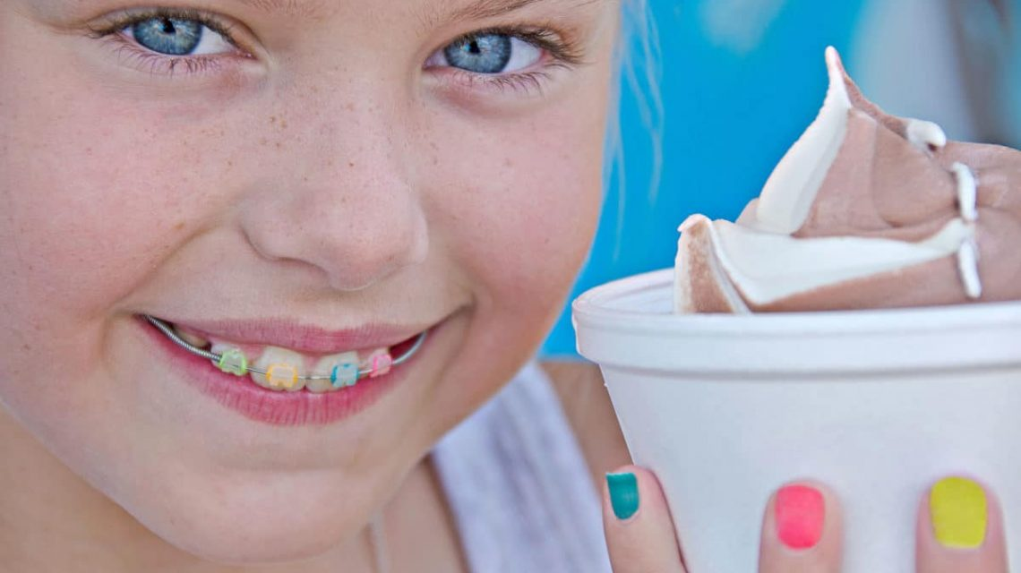 girl smiling with a cup of ice cream