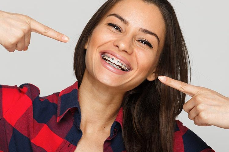 teenager smiling with tulsa braces
