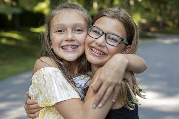 girls smiling with tulsa braces